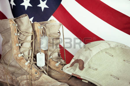 39482433-old-combat-boots-dog-tags-and-helmet-with-american-flag-in-the-background-closeup